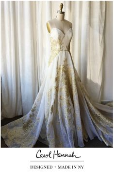 Gold and white wedding gown with texture and floral detail.  Strapless peaked bridal dress with architectural sculptural seaming. Dramatic ballgown for the modern, bohemian, whimsical, ethereal bride.   Unique designer dresses made in new york!