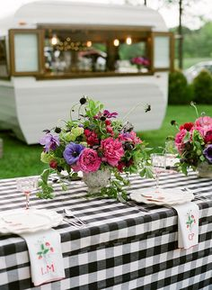 Black and white buffalo check tablecloth with vibrant colorful flowers for a summer bbq tablescape. Southern Spring BBQ in Charlottesville, Virginia Snippet & Ink