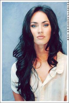 Megan Fox long layered black wavy hair with soft pink makeup