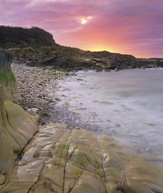 Beautiful summer sunset at  Clashach Cove, Moray, Scotland.