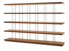 Bookshelf made from hardwood and plywood, with shelves separated by thin stainless steel elements.Potential for flexible design, including the insertion of modules with hinged door or drawer/s assembled with dovetail joints and laterally recessed handle.Available with