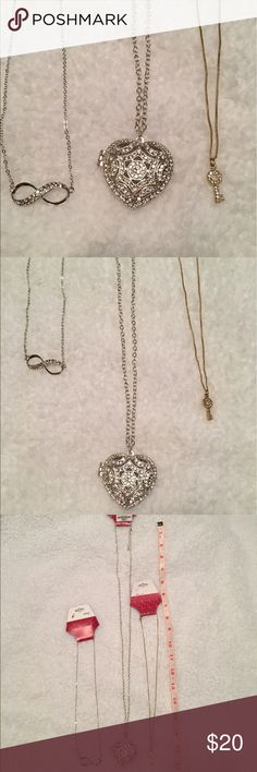 NWT bundle of 3 necklaces from Charming Charlie 1. Silver infinity necklace 2. Silver heart necklace 3. Gold key necklace Charming Charlie Jewelry Necklaces