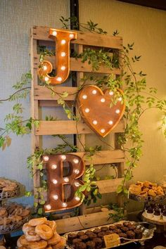rustic wedding dessert table display / http://www.himisspuff.com/wedding-initials-letters-decor-ideas/8/