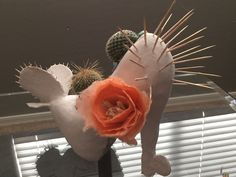 Sculpture using a stiletto heel as a base for Chingona Soles, hosted byTorres Multicultural Communications and Luna Culture Lab in Phoenix, Arizona. Materials: clay, paper, turquoise, live cactus,… Decorated Shoes, Phoenix Arizona, Stiletto Heels, Lab, Cactus, Culture, Turquoise, Paper, Accessories