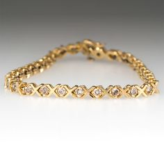 """This classic 3 carat diamond tennis bracelet features """"X"""" links and is set with 32 round brilliant cut light champagne colored diamonds. The bracelet is crafted of solid yellow gold and is finished with a box clasp and safety. Modern Jewelry, Gold Jewelry, Jewlery, Gold Necklace, 3 Karat, Gold Armband, Gold Bracelet For Women, Gold Bangles Design, Bracelet Designs"""