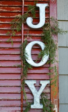 Galvanized letters on shutters with cedar sprigs add a little Christmas Joy to the Potting Shed | homeiswheretheboatis.net #garden