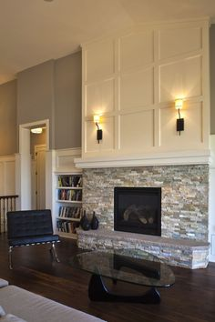 Good idea above the mantle. Would save money by not taking stone all the way to the ceiling