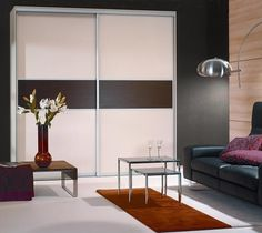 Sliding Doors with Melamine Panels in Tuxedo and Ivory Aluminum hardware