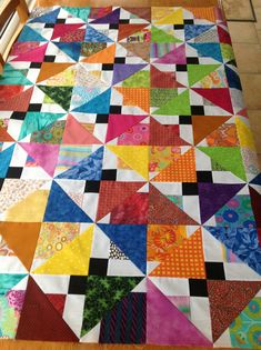 Lynnie It is just an ordinary disappearing 9 patch done with 5 ins squares with a black in center and colours in corners and white in other ...