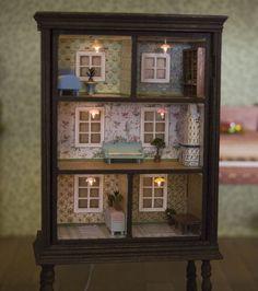 Make an old dresser into a dollhouse.
