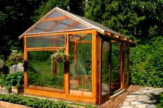 post and beam cedar and glass greenhouse