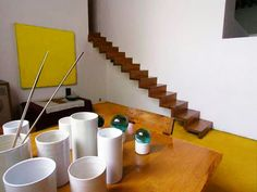 The famous stairs are cantilevered, as you can see in the photo of Luis Barragán below. The planks are embedded 30 cm into what is the thickest wall in the house. Many of the tables and benches in the house are similarly cantilevered via embedding in the walls.