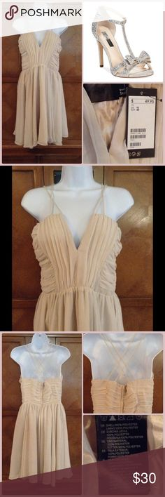 """Beautiful Nude Dress Fun and flirty! Beautiful strap detail. Never been worn. Nude in color. Measurements: Length=37"""". Bust=17 1/2"""". Waist=14 1/4"""". (Tag says size 10 but fits like a 6 see measurements). H&M Dresses"""