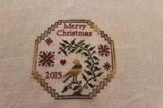 "California Stitcher; ""A Christmas Quaker Medallion"" by Giulia Punti Antichi 36ct Navy Bean Lakeside Linen Threads: Ninas threads - ""A Prim Christmas"", Victorian Motto Sampler Shoppe - ""Dark Pine""."