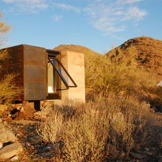 The remains of a former miner's residence in the Arizona desert provided the foundations for this tiny steel and concrete retreat