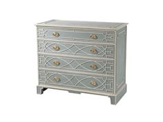 A vintage blue and white painted chest of drawers, the rectangular paneled top and sides above four Chinese Chippendale blind fret paneled drawers, on similar bracket feet.