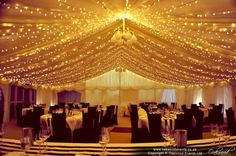 Marquee fairy lights hung as a dense canopy for maximum sparkle & wow factor
