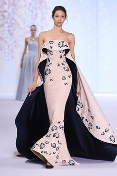 Ralph and Russo SS16 Powder pink silk cr�pe strapless gown elaborately embroidered with floral silk and metallic thread-work, featuring layered faille cape with midnight blue duchess satin lining.