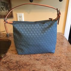 Dooney and Bourke Beautiful denim Dooney and Bourke bag measures 13 x 15 never used handle is patina will change in time Bags Shoulder Bags