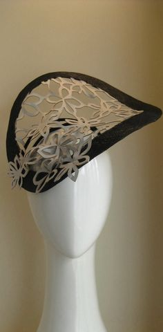 Peek-a-boo lace garden. Rare Italian leather lace wired and edged in contrasting black. Edgy and fun.