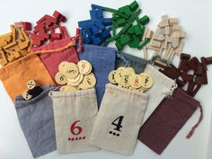 Set of 9 colored drawstring bags that measure approximately 3x5 inches. Included in order: 6 Player Piece Bags: 1 White 1 Blue 1 Orange 1