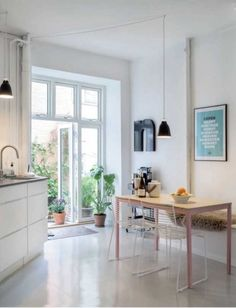 White kitchen with hints of pastel