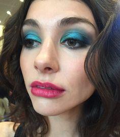 Peacock blue eye shadow and pink lips at Mara Hoffman