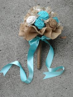 I can make burlap flowers as well but again the blue with the burlap and a hint of lace ties the color scheme together