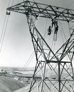 Linemen Working on a Transmission Tower