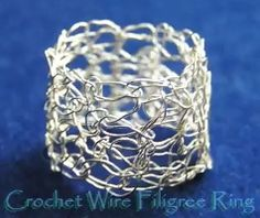 Several tutorials and patterns found on this site :crocheting with wire.