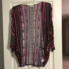 Gorgeous Trendy Boutique Jacket Jacket is fairly long and is rounded around bottom for trendy look.  Worn only handful of times so is in excellent condition.  Size is small but runs big as I normally wear large and this fits me great. Jackets & Coats Capes