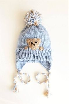 Best 12 Knit winter earflap hat with pom pom, braids and crochet Bear applique sewn onto. Kids will love it! Size- will fit from toddler up to child Color- Blue with Brown applique Materials- soft wool acrylic blended yarn This hat is MADE TO ORDER! Baby Hats Knitting, Knitting For Kids, Baby Knitting Patterns, Knitted Hats, Crochet Hats, Flap Hat, Animal Hats, Crochet Bear, Beanie Babies