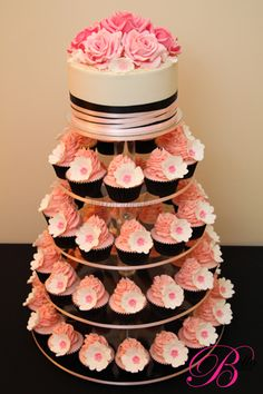 Wedding Cupcake Towers - Definitely want something like this (not the color the setup) but with another tier of cake (because I like the cake cutting and people might want cake) and cupcakes cause we'll have kids and thats easier to handle then trying to make a small piece of cake. This will also save a little money.