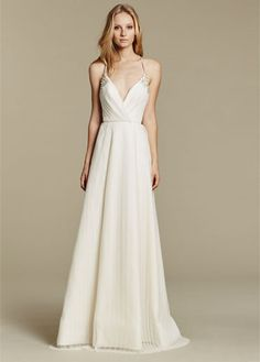 """""""Cosmos"""" gown. Ivory pleated net A-line bridal gown, draped V-neck bodice with delicate straps and beaded applique, full pleated skirt."""