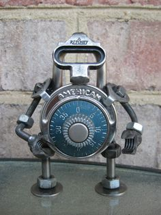 I think this is really cool. I like that a figure is created by regular objects. He is also very robot like, which i really like. The top is the coolest part. Cool head!  Ritchey The LockBot Recycled Metal Sculpture by GeargoyleMetalArt, $40.00