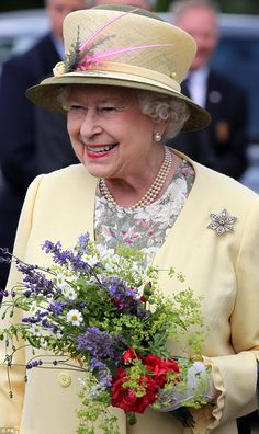 Beaming: The monarch grins as she receives a posy of wild Scottish flowers on a visit to Scone Palace, the home of Earl of Mansfield on 6th July 2012 - the palace was once the site of the crowning of Scottish kings including Macbeth and Robert the Bruce.