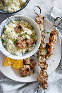 Pork Souvlaki With Lemon Rice | foodiecrush.com-An easy marinade with classic Greek flavors of fruity olive oil, lemon and oregano give a tangy, fresh and distinctly Greek taste to grilled pork skewers.