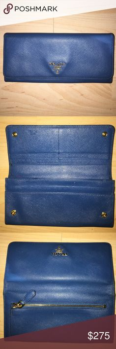Blue Prada Saffiano Leather Wallet Beautiful Wallet. Lights signs of use. Still plenty of life left in this wallet. Clean interior and exterior. Gold tone hardware has light fading. Bags Wallets