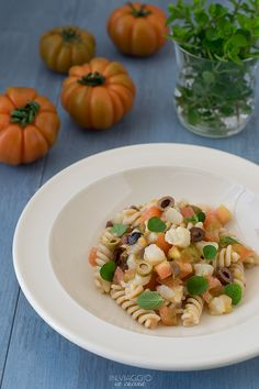 Pasta salad with salt cod tartare, olives and tomatoes