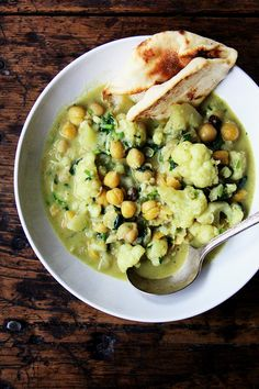 These curried chickpeas come together quickly if you have the chickpeas cooked ahead of time: sauté aromatics, add cooked legume or uncooked lentil (or quick-cooking grain), simmer everything in a mix of coconut milk and water. It's simple and delicious. Healthy, too. // alexandracooks.com