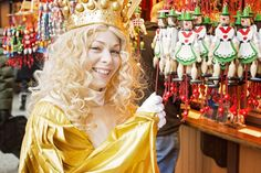 "Christkindlmarket Chicago - ""Christkindl"" - a fairy-like being dressed in gold and white robe with a crown on her golden locks – is especially attractive to younger audience as in the German speaking countries she brings the gifts to the kids."