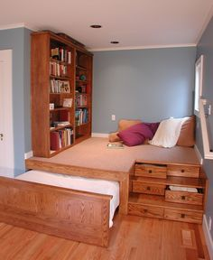 Now talk about space saving! Drawers for stairs, concealable bed, lounging area and a bookshelf all in one space. Genius.