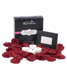 Create the ultimate romantic fantasy wherever you go. Includes more than 100 scented silk red rose petals, four tea lights, and a special invitation.