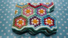Daisy baby blanket made from crocheted hexagons. This pretty handmade baby blanket is made from colourful hexagons with daisy coloured centres. It is made from soft acrylic yarn which is great for delicate skin. The blanket measures appr. Baby Blanket Crochet, Crochet Baby, Handmade Baby Blankets, Daisy, Delicate, This Or That Questions, Afghans, Pretty, How To Make