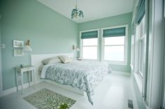 ah! i love this paint colour, so peaceful. And the white floors...mmmm.