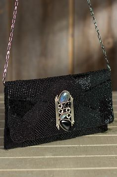 This beaded bag is hand crafted of black onyx and accented with large stones of onyx and labradorite. Free shipping   returns.
