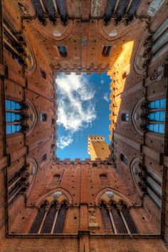 Torre del Mangia - Siena, Italy. When the bell tower of Siena, Italy was built it was one of the tallest towers in Italy. The height was exactly the same as the cathedral, indicating that the church and government has the same power. Today it is a great tourist attraction as we climb the 400+ stairs to the top.
