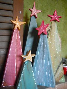 Due to the volume of orders for the Christmas season these may take a week to get to you. These trees are handmade and unique. The trees are made from found wood, painted a variety of colors, and painted with white dots. This listing is for one tree and priced by 12 inches, 10 inches