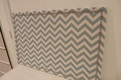 Great idea for a cheap, easy, but beautiful bulletin board.  Use fabric to match decor.