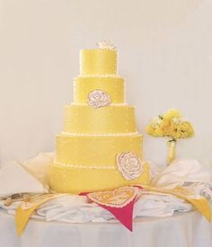 Yellow wedding cake with bouquet